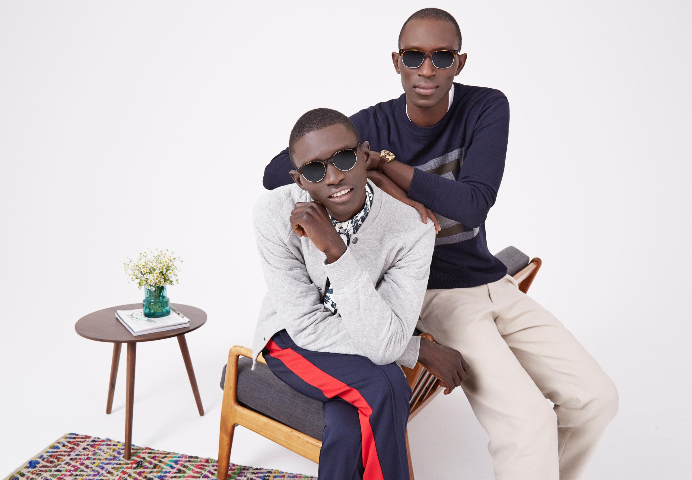 Armando leans on Fernando, both wearing sunglasses